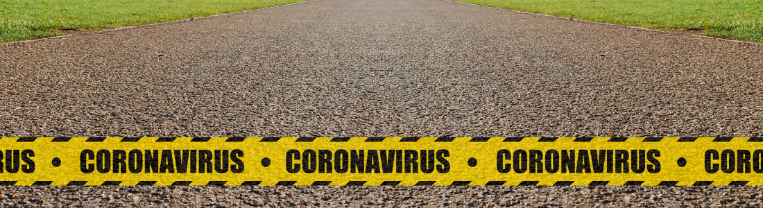 Coronavirus warning across a road