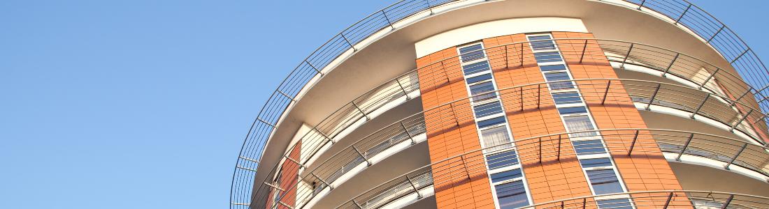Looking up at modern apartment block